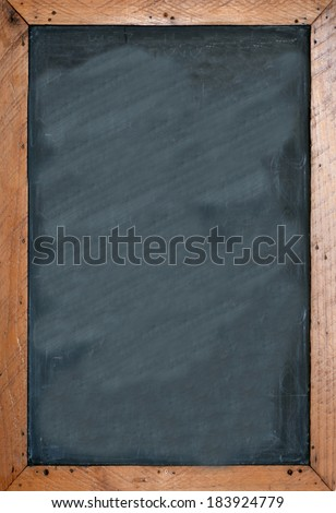 Blank chalkboard with brown wooben frame. Empty space for insertion and to add text. - stock photo