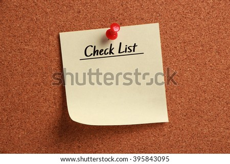 Blank Check List is pinned on corkboard. - stock photo