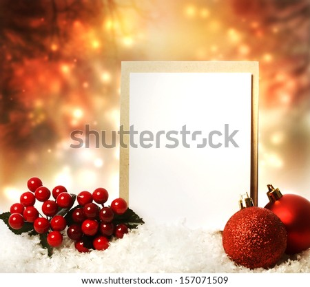 Blank Christmas card with red ornaments at night - stock photo