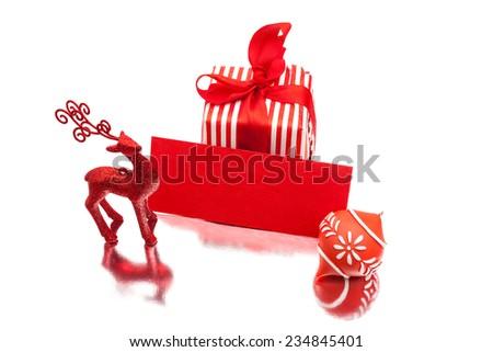 Blank christmas greeting card, deer and gift box on white background.  Christmas greeting card template. - stock photo