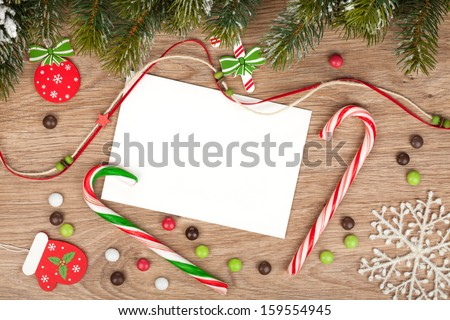 Blank christmas greeting card with fir tree and decor - stock photo