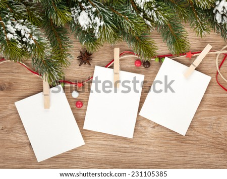 Blank christmas photo frames with fir tree and decor - stock photo