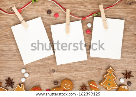 Blank christmas photo frames with homemade gingerbread cookies - stock photo