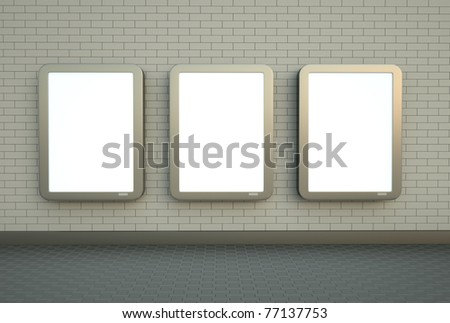 Blank citylight banners hanging on a white brick wall. - stock photo