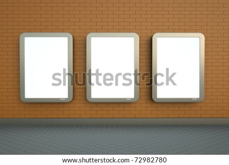 Blank citylight banners hanging on an orange brick wall. - stock photo
