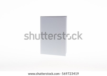 Blank clean white book on a light gradient background