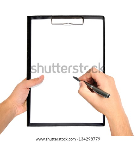 blank clipboard and pen in hand - stock photo