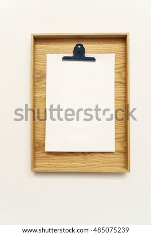Blank clipboard menu interiror isolated on white wall