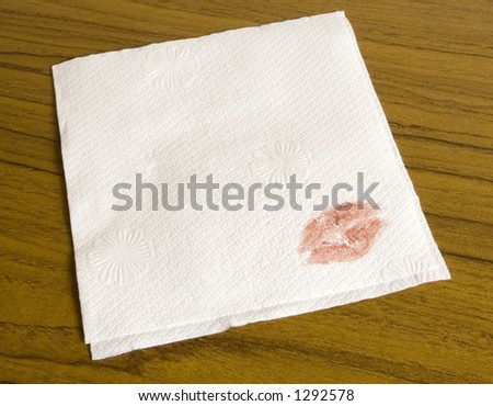 Blank cocktail napkin for your message. With a lipstick imprint in the corner - stock photo
