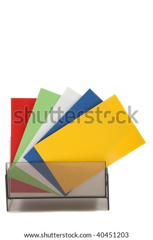 Blank colorful business cards spread out, in holder - stock photo