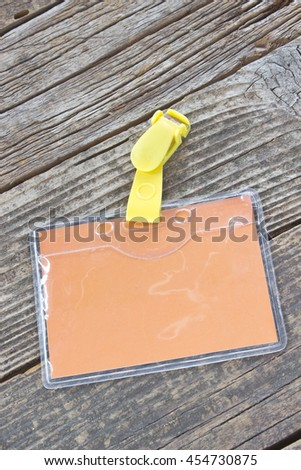 Blank colorful ID card tag on wooden background - stock photo