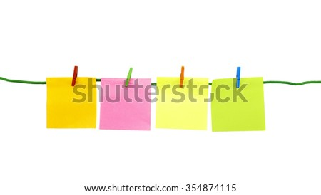 Blank colorful sticky notes hanged on green rope isolated on white background.