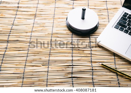 Blank compact disc with cover on laptop keyboard - stock photo