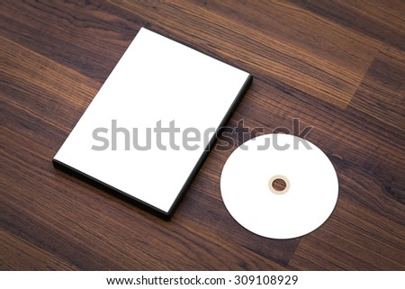 Blank compact disc with cover on wood background ground - stock photo