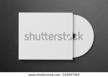 Blank compact disk cover on dark background - stock photo