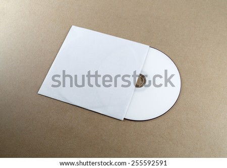 Blank compact disk on a table. Template for branding identity for designers. - stock photo