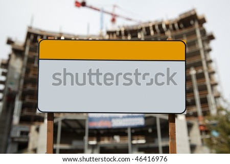 Blank construction sign against construction site - stock photo