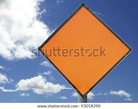 Blank construction sign with space for text/symbol, isolated with clipping path(s) against a blue sky. - stock photo