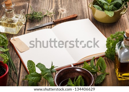 Blank cookbook for recipes on old wooden background - stock photo