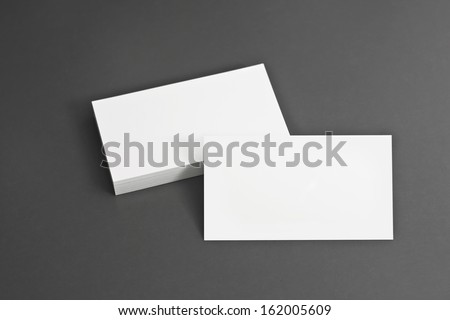 Blank corporate identity package business card with clear gray background. - stock photo