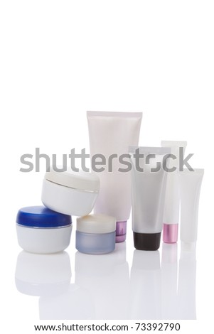 blank cosmetic containers isolated on white - stock photo