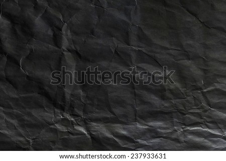 Blank crumpled black paper - stock photo