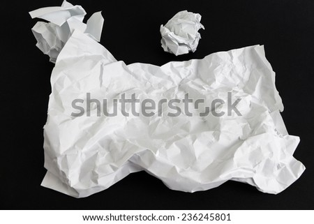 Blank crumpled paper sheet template isolated on black background - stock photo