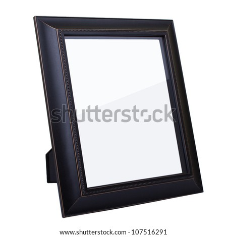 Blank dark wooden picture frame isolated on white background - stock photo