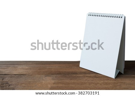 Blank desktop calendar on old wood table isolated white background ,with clipping path - stock photo