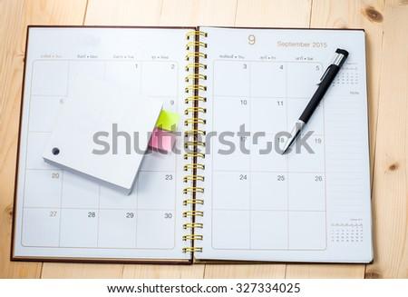 blank desktop calendar with memo paper - stock photo