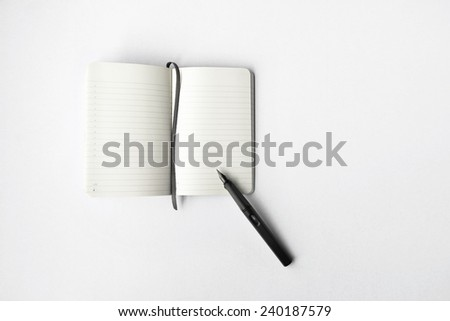 Blank diary and pen on white background