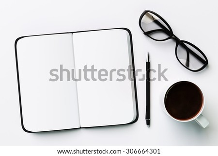 Blank diary, cup of coffee and glasses, on a white background - stock photo