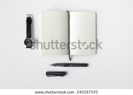 Blank diary, pen, and watch on white background