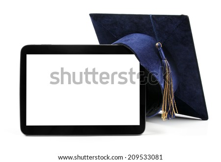 blank digital tablet and education student cap - stock photo