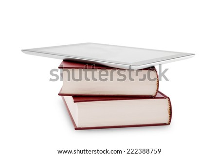 blank digital tablet and stack of books - stock photo