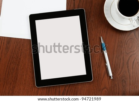 Blank digital tablet on a desk with clipping path for the screen
