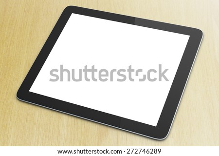 Blank digital tablet on a wooden surface - stock photo