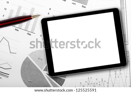 blank digital tablet on business documents - stock photo
