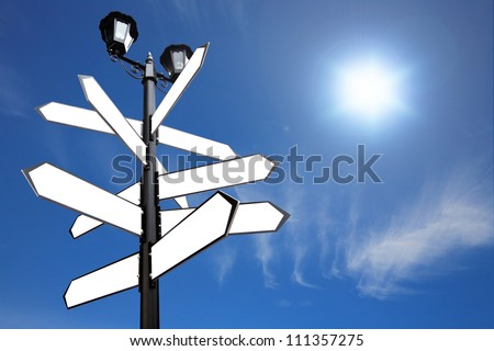 Blank Direction antique road signs - arrows on blue sky. - stock photo
