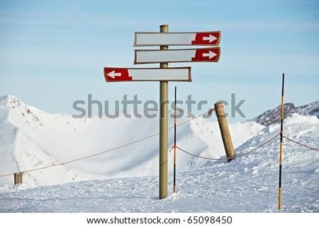 Blank direction signs in a ski resort - stock photo