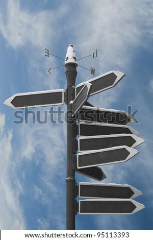 Blank Directional Arrow Sign on blue sky - stock photo