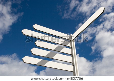 Blank Directional Arrow Sign Post - stock photo