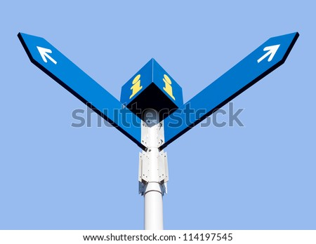 Blank directional road signs over blue sky - stock photo