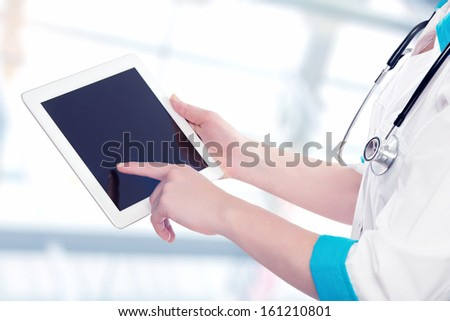 blank empty computer tablet in the hands of doctor - stock photo