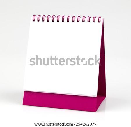 Blank, empty desk calendar, isolated on white background - stock photo