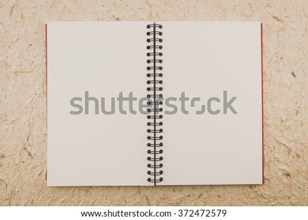 Blank empty notepad on mulberry paper background - Vintage filter effect - stock photo