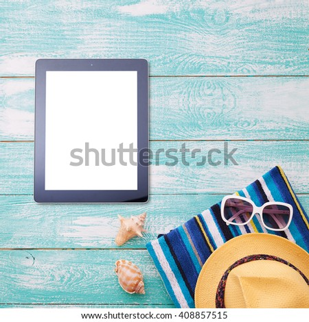 Blank empty tablet computer on beach. Trendy summer accessories on wooden background pool. Flip-flops on beach. Tropical flower orchid. Flat mock up for design. Top view sguare.