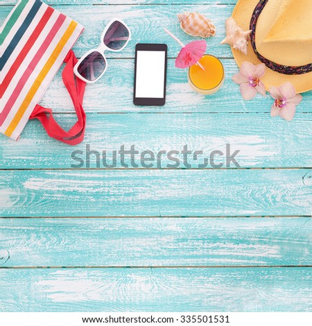 Blank empty tablet computer on the beach. Trendy summer accessories on wooden background pool. Sunglasses, orange juice on beach. Tropical flower orchid. Flat mock up for design.