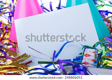 Blank envelope among birthday party decorations - stock photo