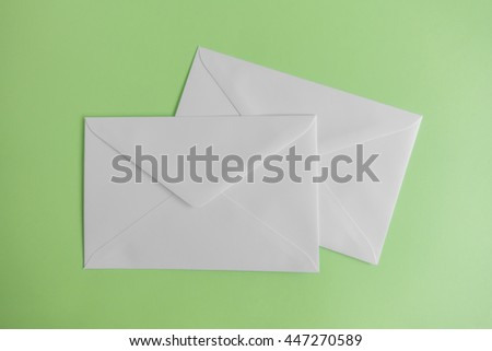 Blank envelope on green background